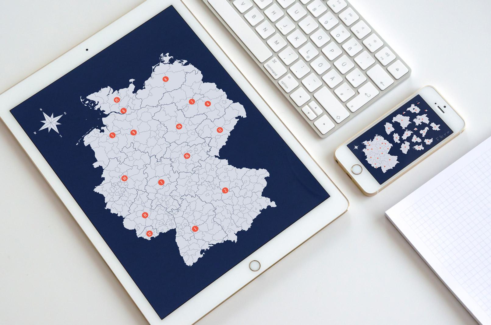 Vektorbasierte Deutschlandkarte, angezeigt auf einem Tablet und einem Smartphone.