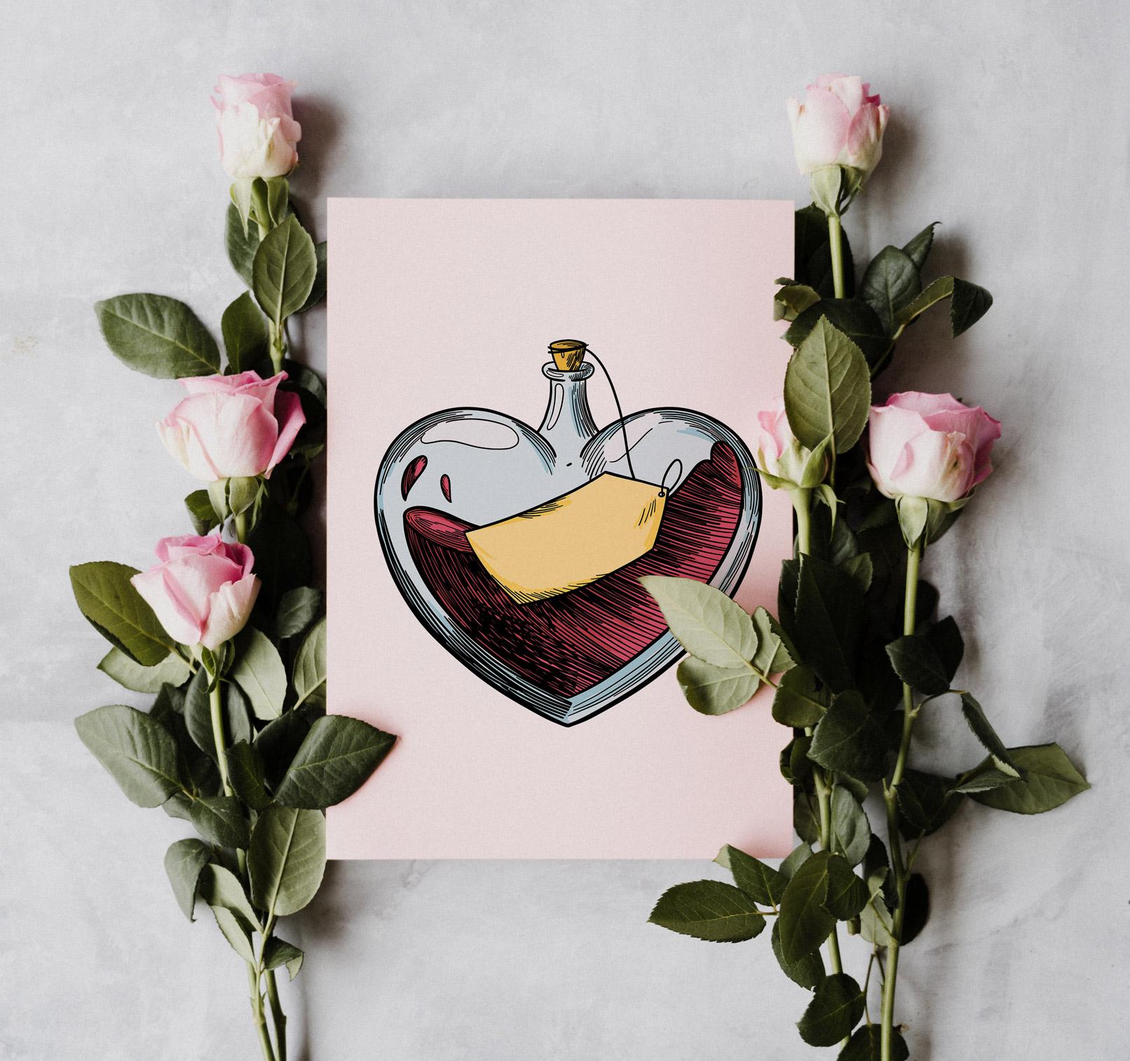 Herz-Grafik auf einer Karte, daneben Rosen