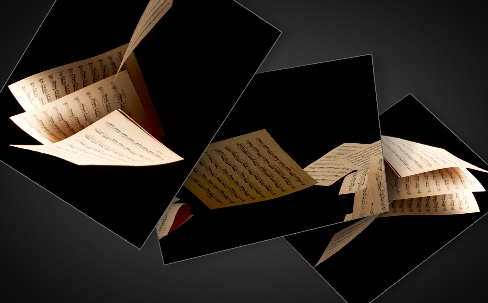 Alte Notenblätter fallen zu Boden – hochaufgelöste Bilder für musikalisch inspirierte Compositings.